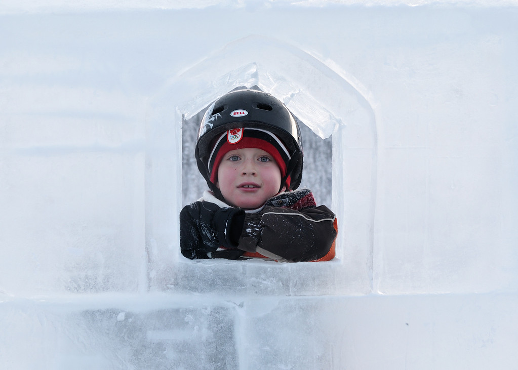 Conor looking through the ice castle window at Lake Louise