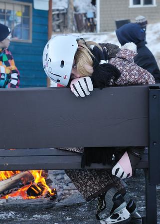 Clare at the fire at Banff Springs skating rink
