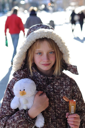 Clare on the streets of Banff with her snowman webkin and caramel candy