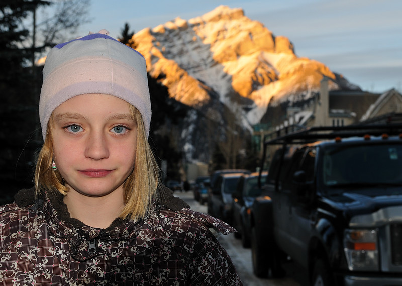 Clare on the streets of Banff, Cascade mountain sunset in the background