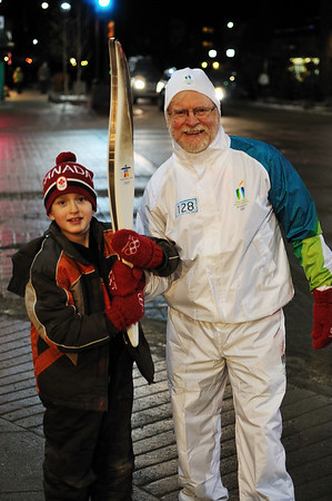 Conor with a torch bearer
