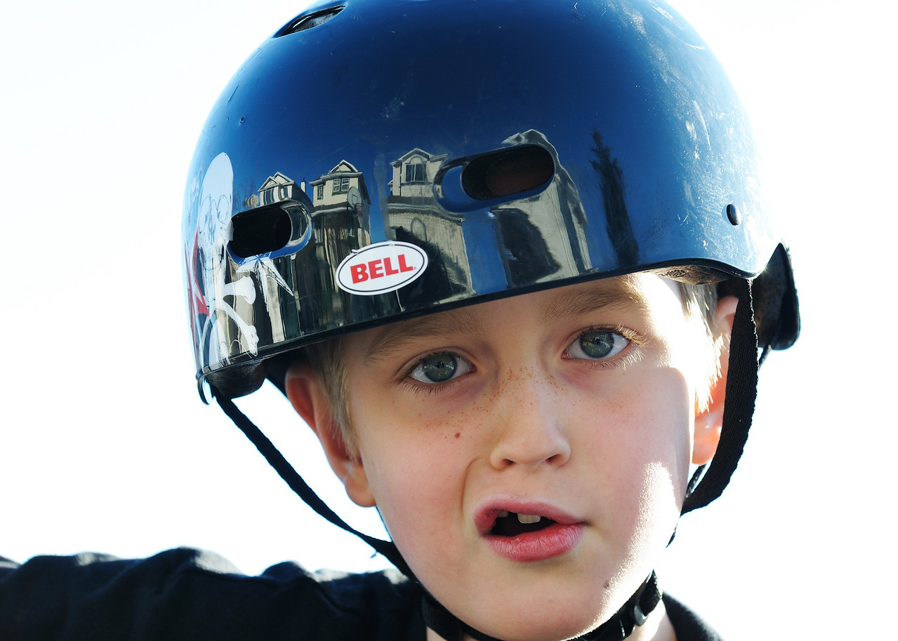 Ha Ha, Conor was riding his bike too.. I love the way the houses were all reflected on his helmet.