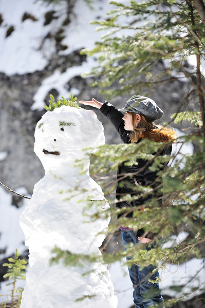 Clare making sure she's taller than the snowman.