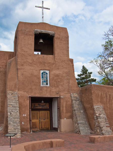 San Miguel, Santa Fe. Considered by some historians to be the oldest place of religious worship still in use in North America. Original church was built sometime after 1605, and destroyed by fire during the Pueblo revolt in 1680. Construction of this church was begun in 1693 and completed in 1710. The stone buttresses were added in 1887.