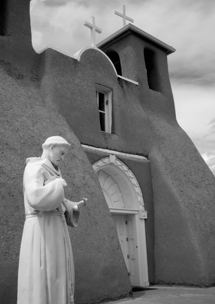 Statue of Saint Francis (San Francisco) in courtyard of the church named for him. Ranchos de Taos.