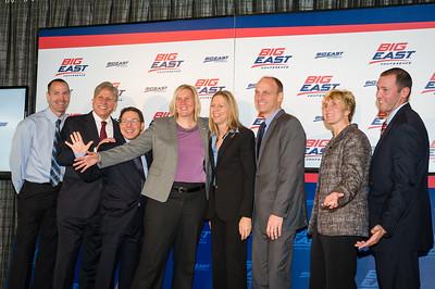 Commissioner Val Ackerman, center, poses with the coaches.  From left: Jim Flanery, Doug Bruno, Tony Bozzella, Susan Robinson Fruchtl, Brian Neal, Terri Mitchell, Joe Tartamella.