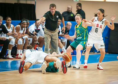 USA guard Diana Taurasi and Australian forward Penny Taylor -- teammates on the WNBA's Phoenix Mercury -- scramble for possession on the floor as Kristi Harrower, Sue Bird and USA head coach Geno Auriemma look on.