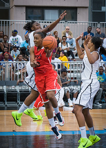 NIke Women's Challenge: West 4th St. All Stars (White) v Uptown Challenge (Red), Rivington Court, New York, NY. July 25, 2012.