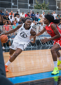 Michelle Campbell, Tajay Ashmeade NIke Women's Challenge: West 4th St. All Stars (White) v Uptown Challenge (Red), Rivington Court, New York, NY. July 25, 2012.