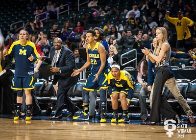Michigan head coach Kim Barnes Arico and the Wolverines bench