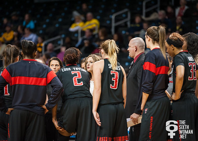 Texas Tech head coach Candi Whitaker talks to her team during a timeout.