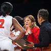 Rutgers head coach C. Vivian Stringer, Asst. Coach Tasha Pointer and Kahleah  Copper #2 during a timeout.