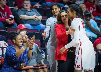 The Rutgers coaching staff greets Betnijah Laney as she exits the game.