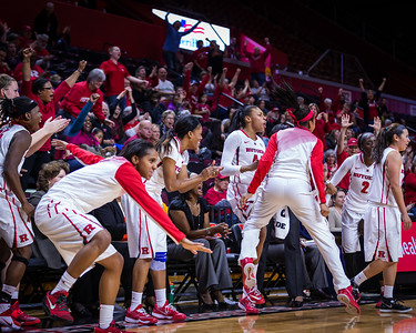 The Rutgers bench celebrates scoring 100 points