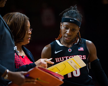 Rutgers head coach C. Vivian Stringer discusses a play with Syessence Davis