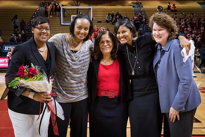 Rutgers head coach C. Vivian Stringer, center, celebrated after the game for achieving the most wins BIg Ten women's basketball history, with her staff, from left: Michelle Edwards, Tia Jackson, Chelsea Newton, & Betsy Yonkman.