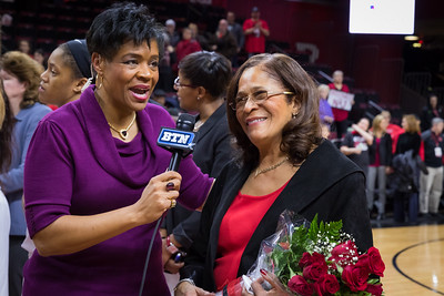 Vera Jones with Rutgers head coach C. Vivian Stringer, who was celebrated after the game for achieving the most wins BIg Ten women's basketball history.