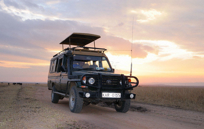 Our sunworld safari Land Cruiser with Ken Naikuni on the wheels in Masai Mara, Kenya, Africa.