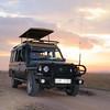 Our sunworld safari Land Cruiser with Ken Naikuni on the wheels in Masai Mara, Kenya, Africa.