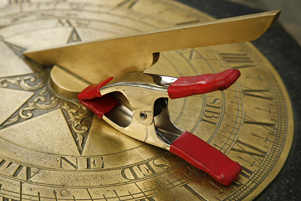 Sun dial and clamp