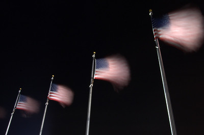 Flags waving at night