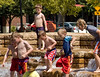 Boys in fountain, Jamison Square, Portland
