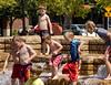 Boys in fountain, Jamison Square, Portland