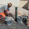 Worker repairing cobblestone sidewalk