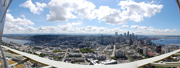 I like the clouds' shadows. View the full version: http://photos.kevinworkman.com/Pictures/2011/i-CmV6sPw/1/O/SeattlePanorama3.jpg