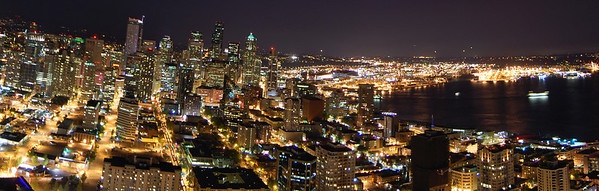 Panorama of Seattle at night. Full version: http://photos.kevinworkman.com/Pictures/2011/i-QRQcV8L/1/O/SeattleNightPanorama11.jpg