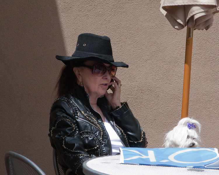Woman with cell phone and dog, Santa Fe, NM
