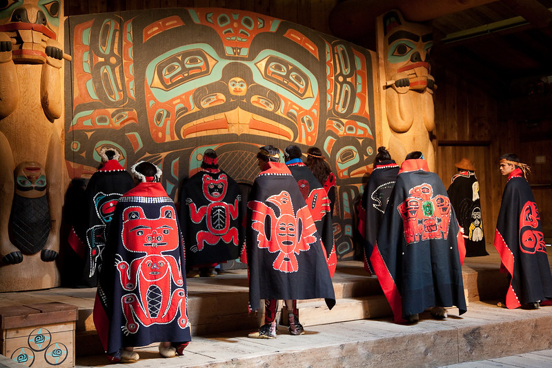 Tlingit dancers at Saxman Village near Ketchikan. The backs of their capes depict the clan to which they belong.