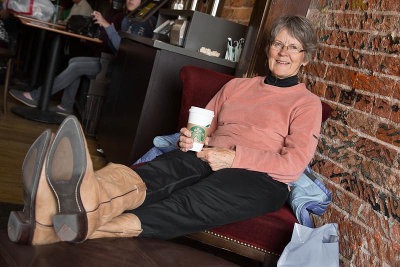 Margaret with her new boots enjoying a Starbucks latte in Santa Fe