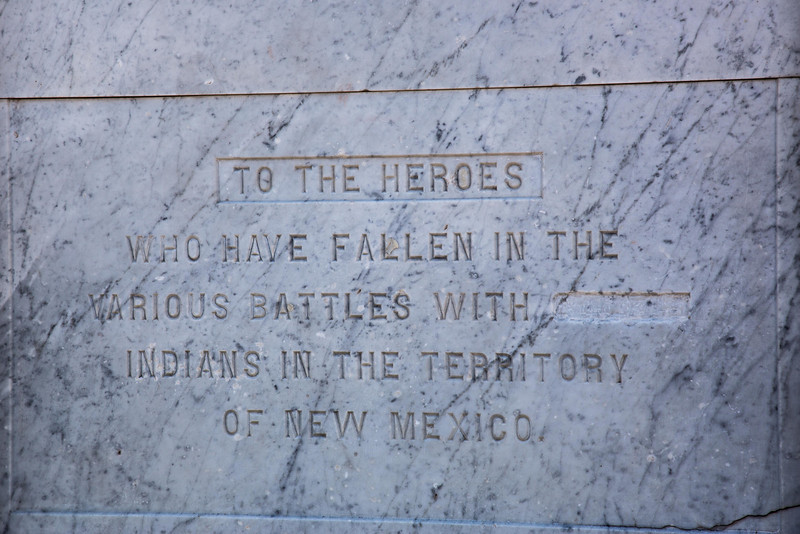 "Monument in the Plaza, Santa Fe. ""To the Heroes Who Have Fallen in the Various Battles With Savage Indians in the Territory of New Mexico"". Unknown persons chiseled out the word, Savage, and it was never repaired."