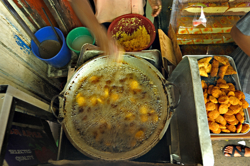 Cooking food in a street market in Kandy, Sri Lanka during a budh purnima festival.