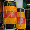 Drums for sale in a street market in Kandy, Sri Lanka during a budh purnima festival.