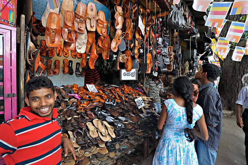 Shoe shop in a street market in Kandy, Sri Lanka during a budh purnima festival.
