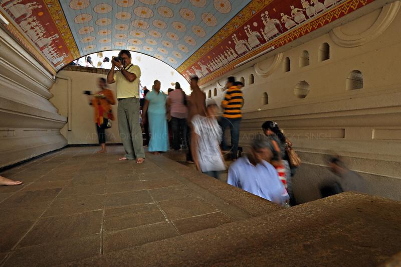 Pilgrims in the Sri Dalada Maligawa or temple of the tooth relic in Kandy, Sri Lanka