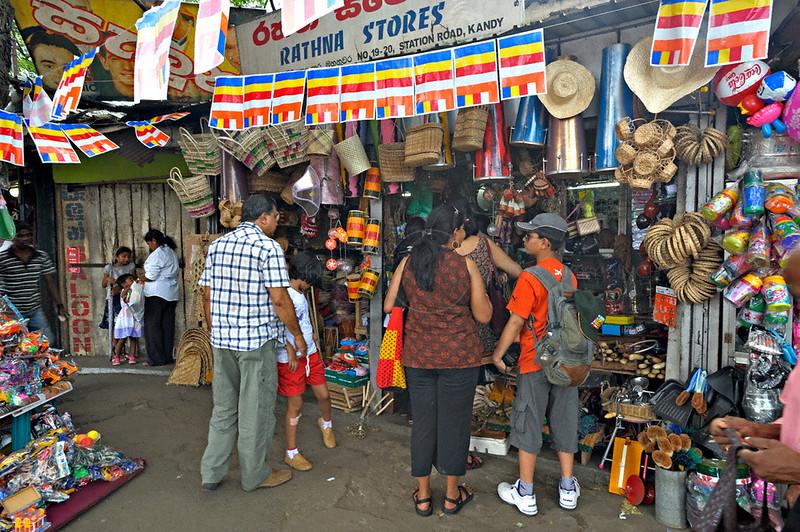 Shops in a street market in Kandy, Sri Lanka during a budh purnima festival.