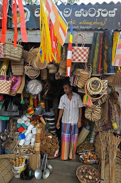 Shopkeeper in a street market in Kandy, Sri Lanka.