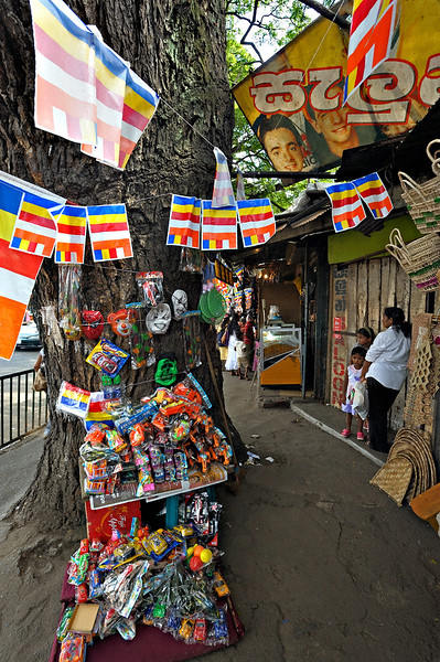 Shops in a street market in Kandy, Sri Lanka during a budh purnima festival.
