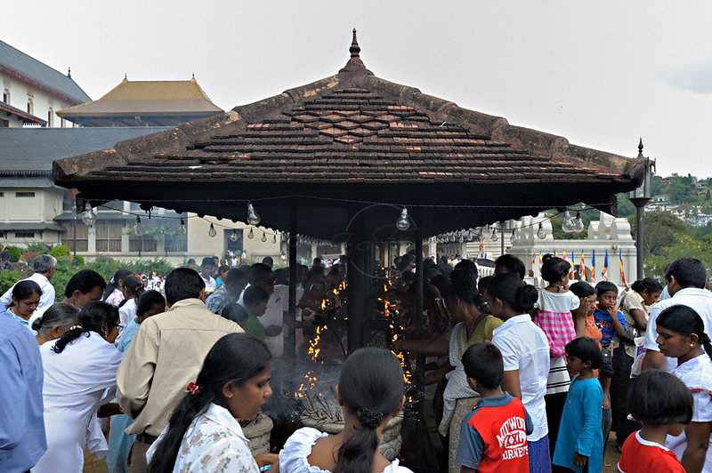 Pilgrims in the Sri Dalada Maligawa or temple of the tooth relic in Kandy, Sri Lanka