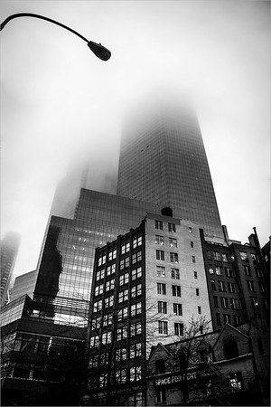 The fog hides the skyscrapers