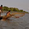 Fishermen in rural Bengal (Sundarbans) casting a net