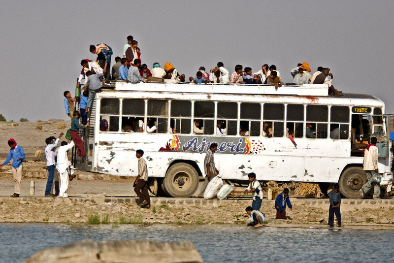 Passengers getting off a bus in rural India
