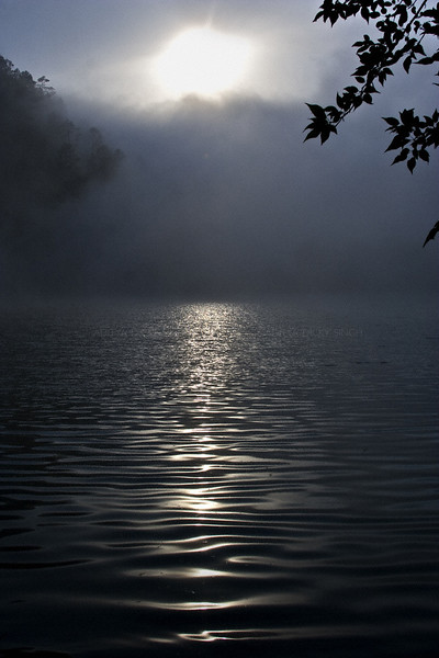 Sunset and fog in a Himalayan lake in Uttarakhand