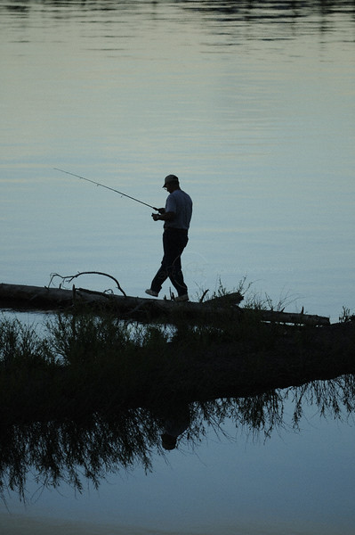 Silhouette of an angler in Yellowstone national park, Wyoming, USA