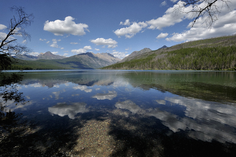 Clouds reflecting in the Kitla lake in Glacier national park during the summers