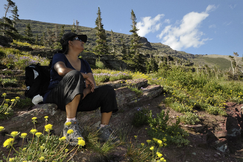 Resting hiker in the Many Glaciers area of the Glacier national park in Montana, USA