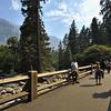 Visitors on a bridge over a stream in Yosemite national park, California, USA